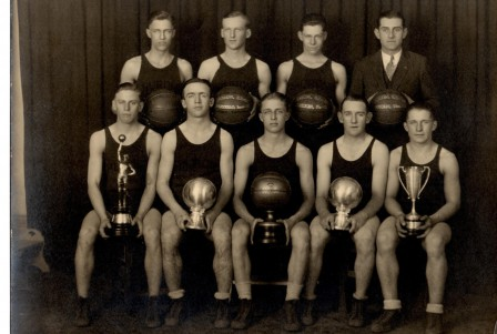 "Huron High School players display trophies won during the 1927 season. From left, front, Harold Marquis, Harold Crawford, Conrad ""Cornie"" Collin, Lawrence Sheridan, Kenneth Hoppell. Back, Percy Washabaugh, Sam Perrin, Arthur Campbell, Coach Frank Coffey."
